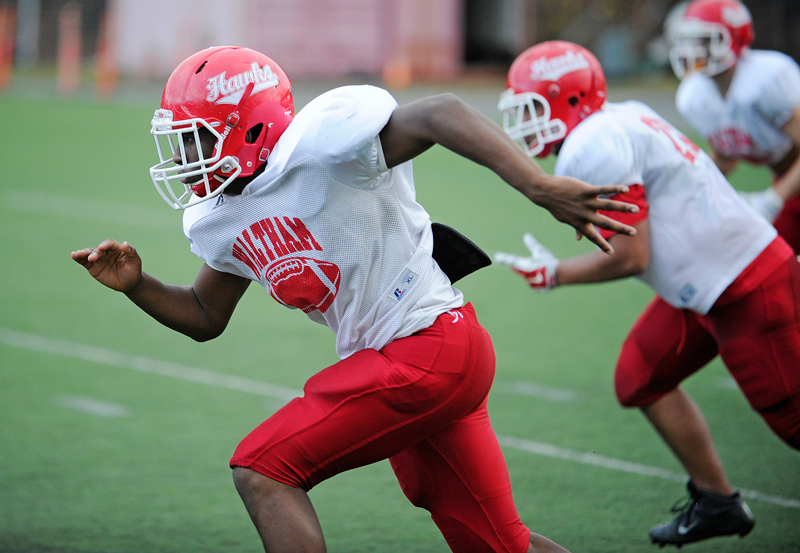 Waltham senior captain Terrance Charles runs in a play during a drill at practice at Kenneth Harding Field at Waltham High School on Monday, Nov. 24, 2014. (Wicked Local Staff Photo / Brett Crawford)