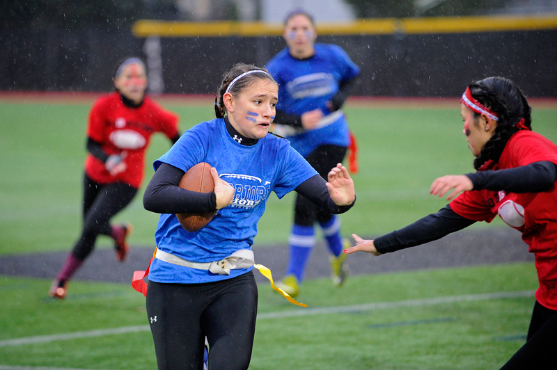 Brookline senior Sophia Poole runs with the ball during Brookline High School's annual powder puff flag football game vs. the juniors at Parsons Field on Wednesday, Nov. 26, 2014. (Wicked Local Staff Photo / Brett Crawford)
