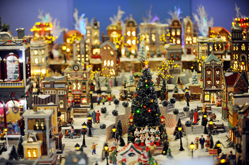 A view of a section of Needham resident William Meagher's Snow Village display he donated for Massachusetts Horticultural Society's 2014 Festival of Trees in Wellesley on Friday, Nov. 28, 2014. The festival runs Nov. 28 through Dec. 14, 2014. (Wicked Local Staff Photo / Brett Crawford)