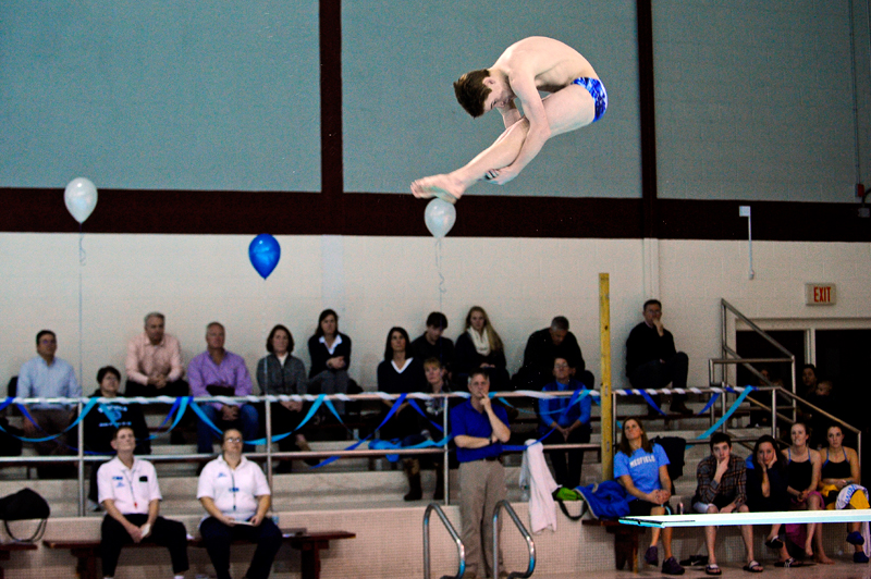 Dover-Sherborn's Mike Chirico performs a dive during a meet against Medfield at the Anthony P. Mucciaccio Pool in Dedham on Friday, Jan. 23, 2015. (Wicked Local Staff Photo / Brett Crawford)