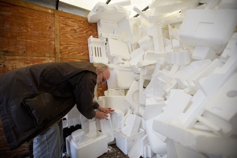 Todd Sjoblom of Brookline piles styrofoam in the back of a trailer to be recycled on Saturday, Feb. 7, 2015 at the 3R Depot, a part of Brookline's 5th annual Climate Week, at the town hall. (Wicked Local Staff Photo / Brett Crawford)