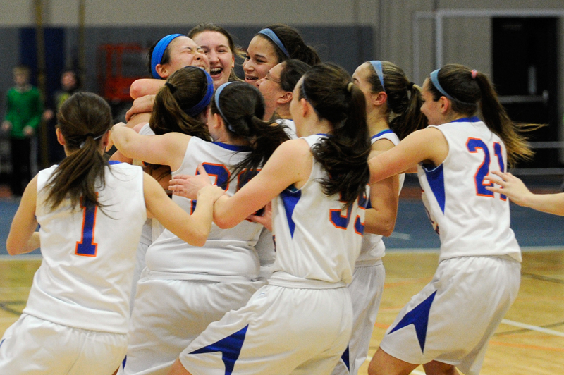 Newton South's Emily Chang (back left) celebrates with teammates after scoring her 1,000th point during a game against Marshfield on Thursday, Feb. 26, 2015.  (Wicked Local Staff Photo / Brett Crawford)