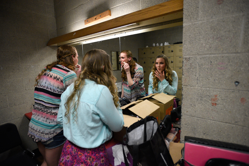 """Dedham High School seniors Alison Sullivan, 18, (left) and Kristiana Grinbergs, 18, get ready backstage before opening night of """"Legally Blonde: The Musical"""" at the James F. Dunne Auditorium on Friday, Mar. 13, 2015.(Wicked Local Staff Photos / Brett Crawford)"""