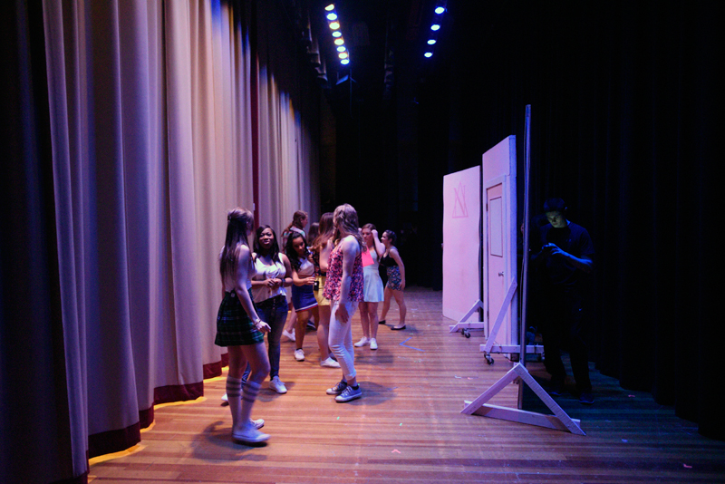 """Dedham High School cast members prepare just before the curtain went up for the school's production of """"Legally Blonde: The Musical"""" at the James F. Dunne Auditorium on Friday, Mar. 13, 2015. (Wicked Local Staff Photo / Brett Crawford)"""