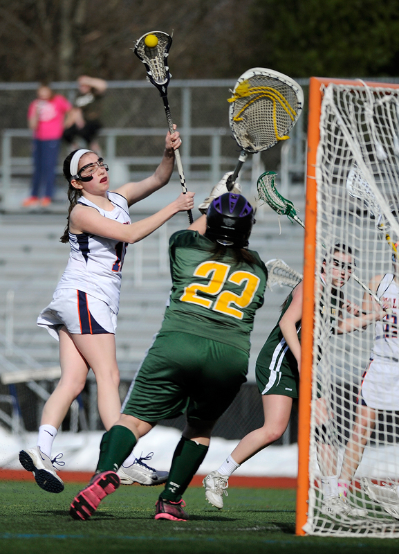 Walpole's Meghan Sundstrum takes a shot as King Philip goalie Maria Woodall defends her net on Monday, Apr. 6, 2015. (Wicked Local Staff Photo / Brett Crawford)