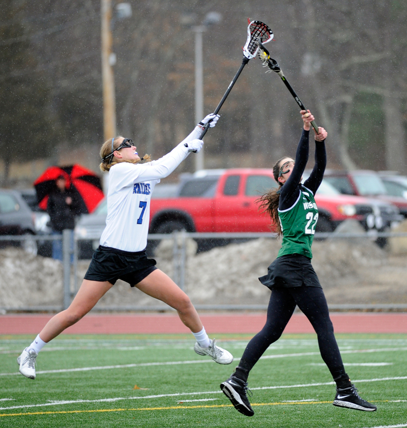 Westwood's Andrea Meincke (right) gains possession of the ball while battling with Dover-Sherborn's Ali Jordan on Tuesday, Apr. 7, 2015.(Wicked Local Staff Photo / Brett Crawford)