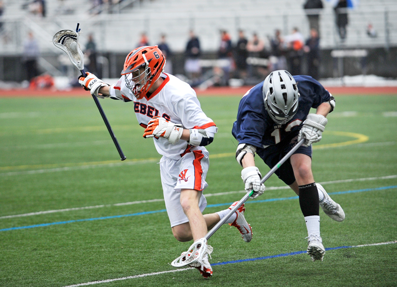Walpole's Ben Lucas keeps possession as Brookline's Joseph Hartigan tries to free the ball on Friday, Apr. 10, 2015. (Wicked Local Staff Photo / Brett Crawford)