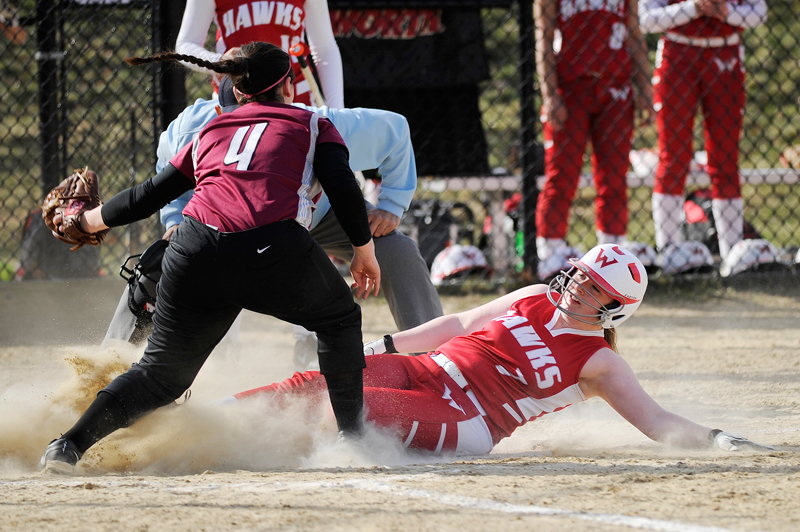 Waltham's Julianna McGovern slides safely into home plate as Weston's Katherine Nardone tries to tag on Thursday, Apr. 16, 2015 at Field. (Wicked Local Staff Photo / Brett Crawford)
