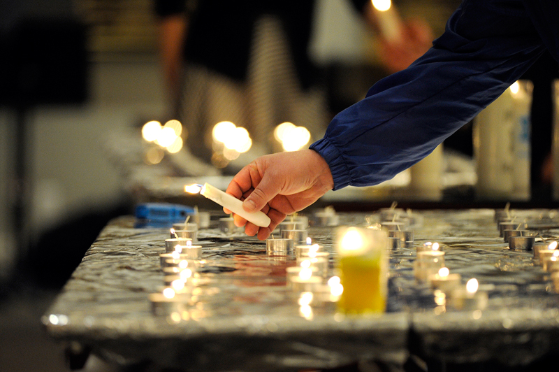 "Candles are lit during the annual Yom HaShoah v'HaG'vurah, ""Day of Remembering the Holocaust and the Bravery,"" at Temple Sinai in Sharon on Thursday, Apr. 16, 2015. (Wicked Local Staff Photo / Brett Crawford)"