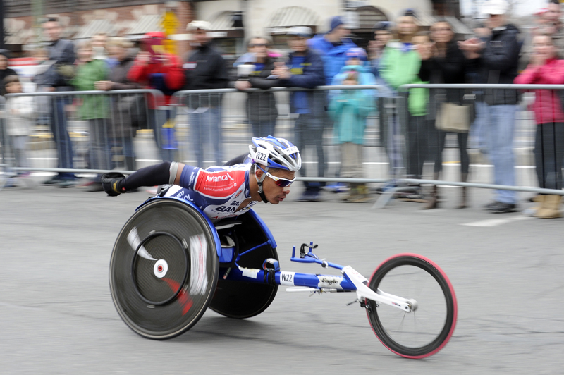 Laurens Molina of Costa Rica pushes down Beacon St. in Coolidge Corner during the 119th Boston Marathon on Monday, Apr. 20, 2015.  (Wicked Local Staff Photo / Brett Crawford)