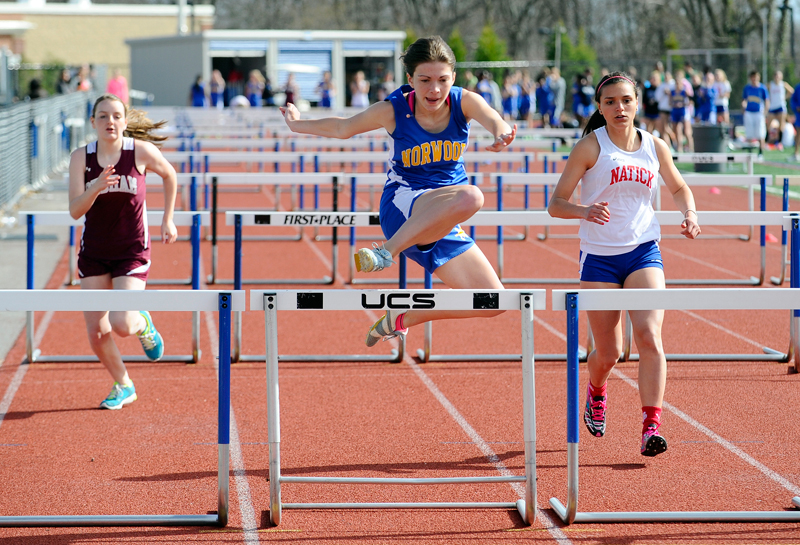 Norwood's Nicole Marchant competes in the hurdles during a track and field tri-meet with Dedham and Natick at Norwood High School on Wednesday, Apr. 29 2015. (Wicked Local Staff Photo / Brett Crawford)
