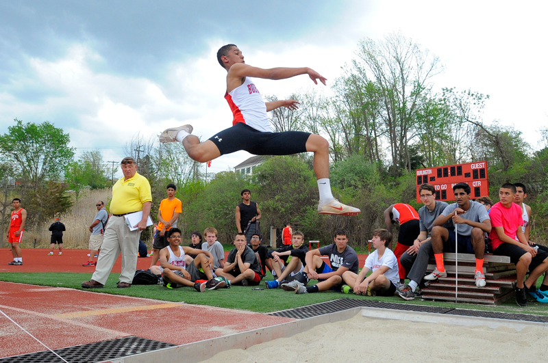Burlington senior Michael Singh competes in the long jump during a meet against Wakefield on Tuesday, May 12, 2015. (Wicked Local Staff Photo / Brett Crawford)