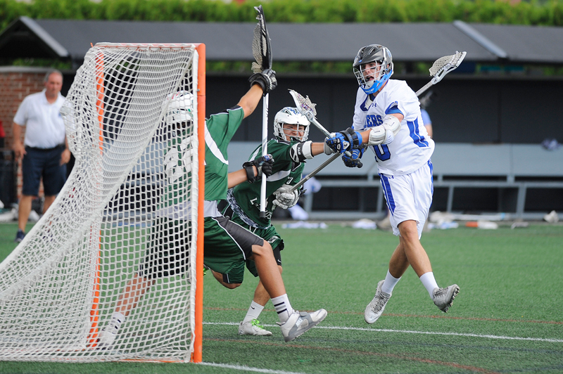 Dover-Sherborn's Christopher Williams fires a shot for a goal past Grafton goalie Cadrin Msumba while defended by Youki Azuma during the boys Div. 3 lacrosse state final on Friday, June 19, 2015 at Soldiers Field Stadium at Harvard University in Allston. Dover-Sherborn won 14-2. (Wicked Local Staff Photo/Brett Crawford)