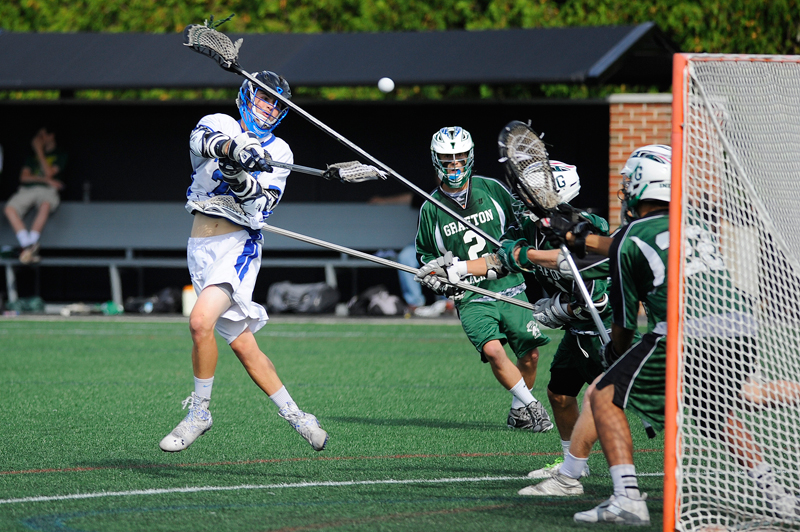 Dover-Sherborn's William Spangenberg fires a shot during the boys Div. 3 lacrosse state final against Grafton on Friday, June 19, 2015 at Soldiers Field Stadium at Harvard University in Allston. Dover-Sherborn won 14-2. (Wicked Local Staff Photo/Brett Crawford)