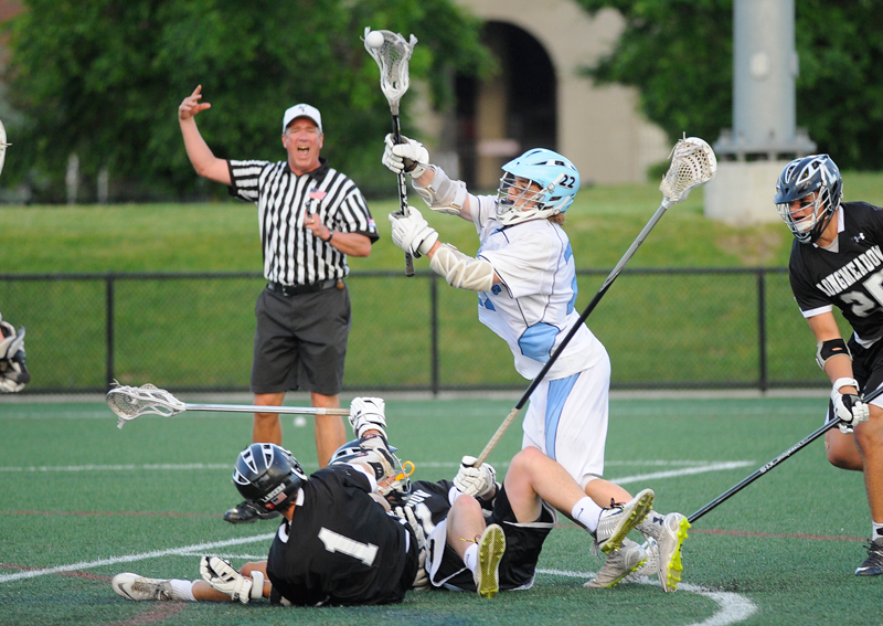 Medfield's Sam Hurley fires a shot over Longmeadow defensemen during the boys Div. 2 lacrosse state final on Friday, June 19, 2015 at Soldiers Field Stadium at Harvard University in Allston. Medfield won 16-12.(Wicked Local Staff Photo/Brett Crawford)