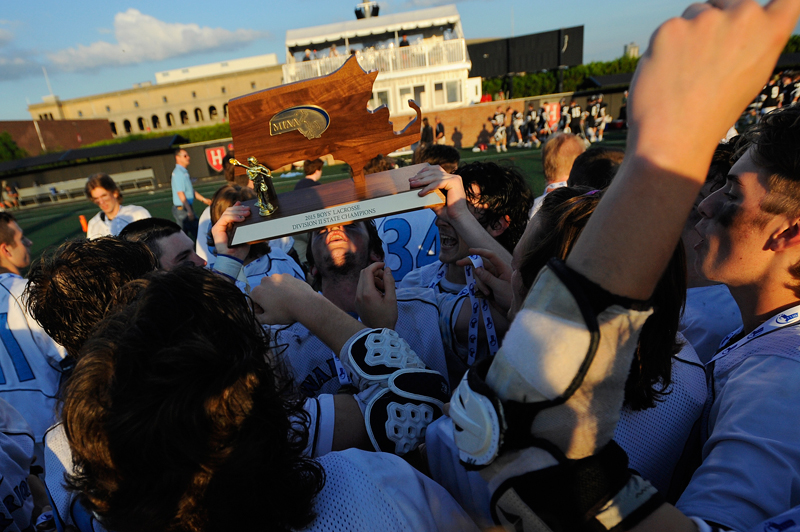 Medfield's Will Murphy lifts the boys lacrosse Div. 2 state final champions trophy after defeating Longmeadow 16-12 on Friday, June 19, 2015 at Soldiers Field Stadium in Allston.(Wicked Local Staff Photo/Brett Crawford)
