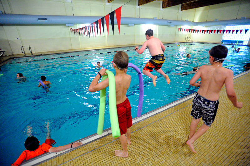 Campers swim during the first day of Summer Adventure camp at the Watertown Boys & Girls Club on Tuesday, June 30, 2015. For the first week, the camp is being held at the Watertown facility and will move to Hale Reservation in Westwood after the July 4th weekend. (Wicked Local Staff Photo/Brett Crawford)