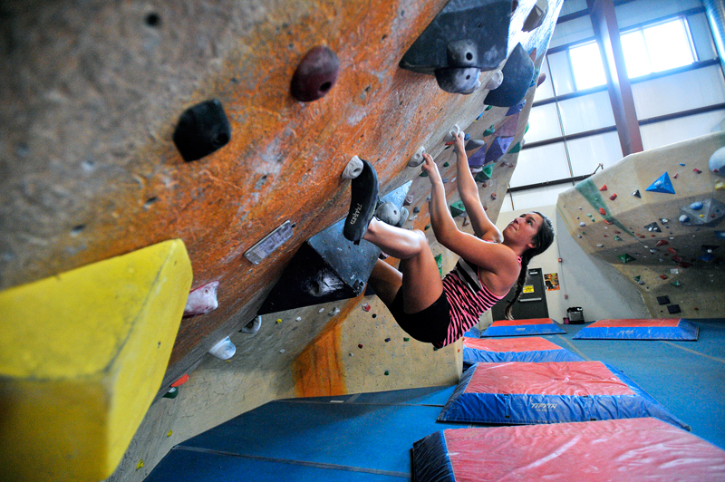 Amelia Metcalf, 19, of Newton climbs on a bouldering wall at Central Rock Gym in Watertown on Monday, July 27, 2015. (Wicked Local Staff Photo/Brett Crawford)