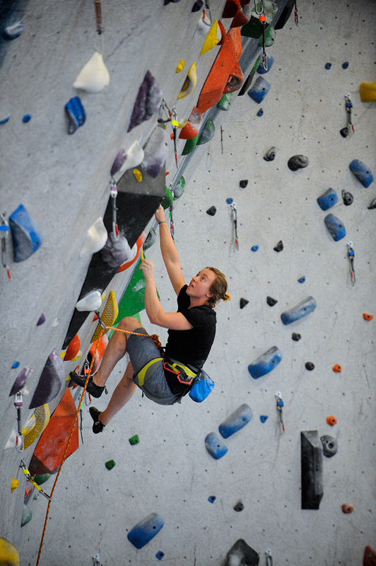 Flannery Shay-Nemirow, 23, of Watertown climbs at Central Rock Gym in Watertown on Monday, July 27, 2015. (Wicked Local Staff Photo/Brett Crawford)
