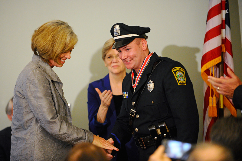 Watertown Police Officer Joseph B. Reynolds is honoredon Friday, July 31, 2015 at the Watertown Police Department by United States Representative Katherine M. Clark.(Wicked Local Staff Photo/Brett Crawford)