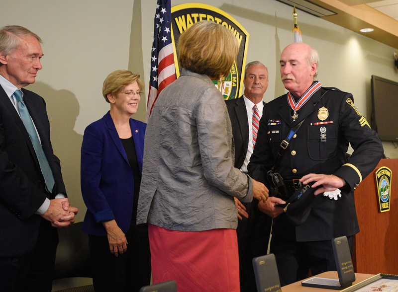 Watertown Police Sergeant Jeffrey J. Pugliese is honored by United States Representative Katherine M. Clark on Friday, July 31, 2015 at the Watertown Police Department. Standing in back from left is United States Senator Edward J. Markey, United States Senator Elizabeth A. Warren, and Retired Watertown Police Chief Edward P. Deveau.(Wicked Local Staff Photo/Brett Crawford)