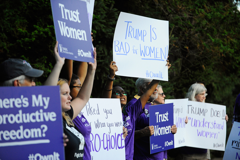 Members of NARAL Pro-Choice Massachusetts protest against Donald Trump outside of Ernie Boch Jr.'s mansion. (Wicked Local Staff Photo/Brett Crawford)