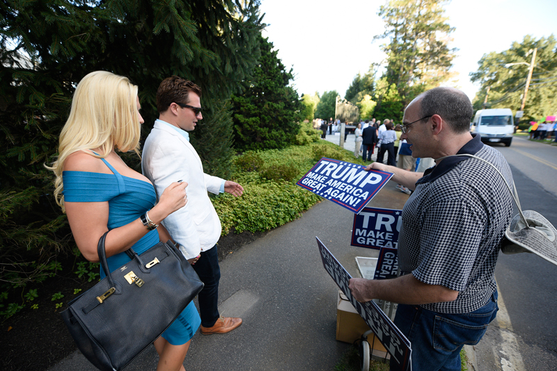 Frank Ricci of Johnston, Ri. hands out signs in support of Donald Trump.(Wicked Local Staff Photo/Brett Crawford)