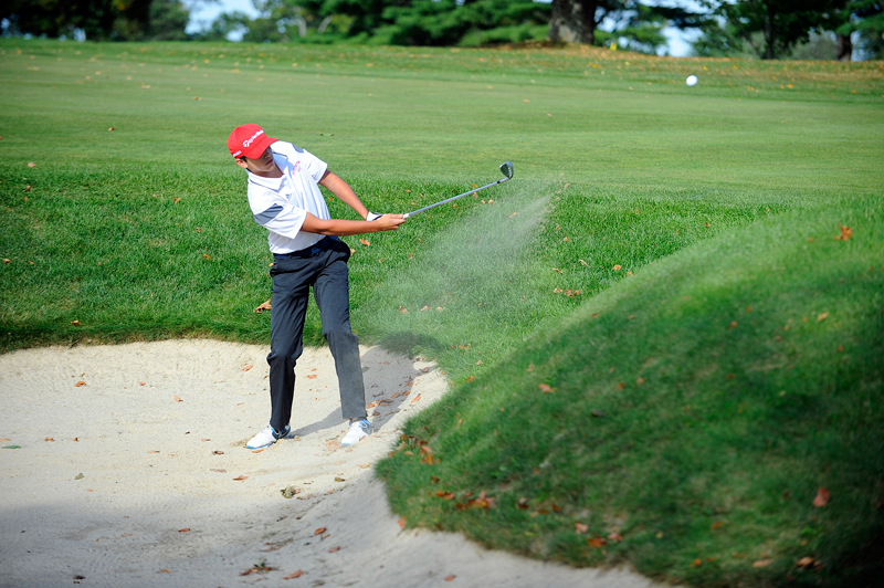 Burlington junior Joe Saia hits out from a bunker during a match against Watertown at the Oakley Country Club in Watertown on Tuesday, Sep. 22, 2015. (Wicked Local Staff Photo/Brett Crawford)