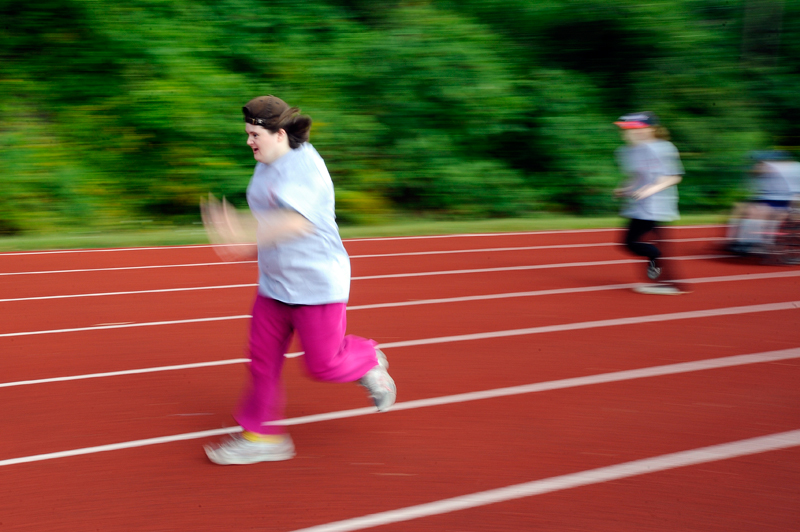 Shannon Kelley of Needham runs in a race at the 27th annual Ellie Bloom Special Olympics at DeFazio Park in Needham on Saturday, Sep. 19, 2015. (Wicked Local Staff Photo/Brett Crawford)
