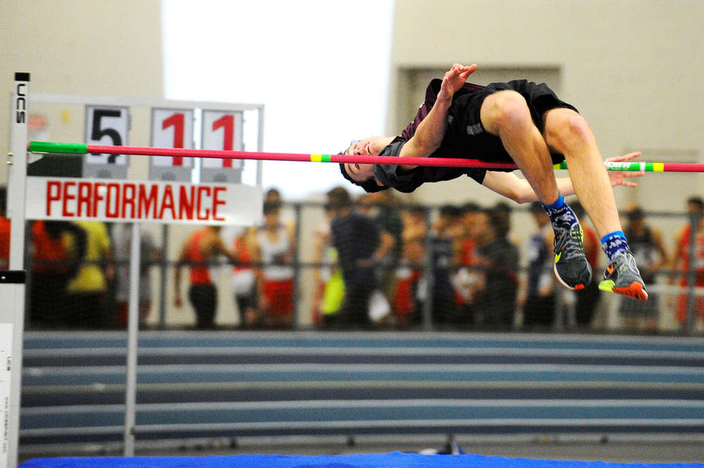 Arlington's Garth Hull clears the 5' 11'' mark in the high jump at a Middlesex League meet at the Reggie Lewis Track and Athletic Center in Boston on Tuesday, Dec. 29, 2015.