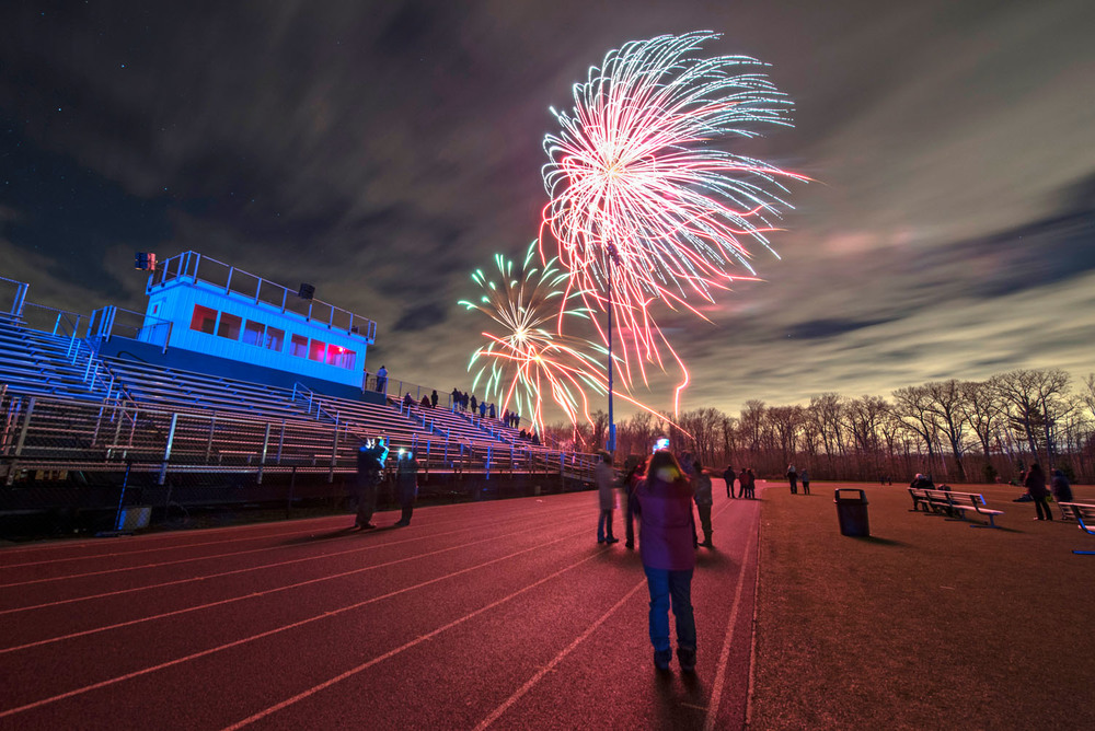 Locals enjoy the New Year's Eve fireworks put on by Atlas Fireworks at Westwood High School on Thursday, Dec. 31, 2015.