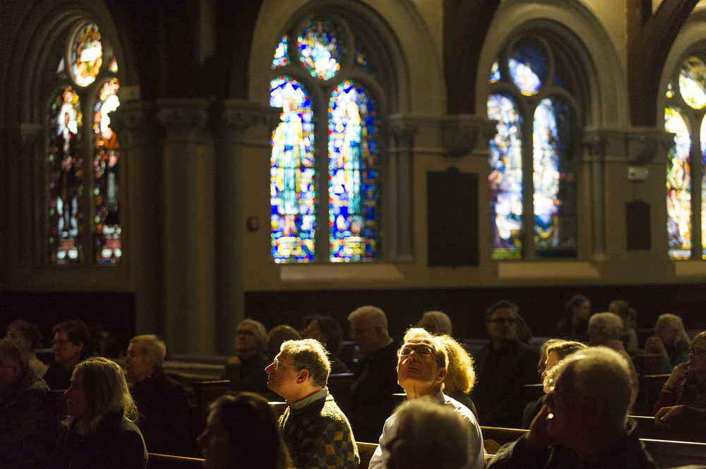 Attendees learn about the stained glass windows at First Parish in Brookline during a tour of them put on by the Brookline Historical Society on Sunday, Feb. 6, 2016.