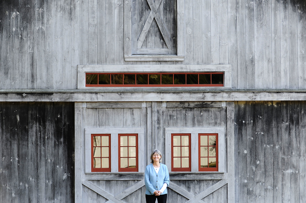 Sally Schnitzer, Concord's 2016 Honored Citizen, stands in front of her barn at her home in Concord on Tuesday, Mar. 8, 2016.