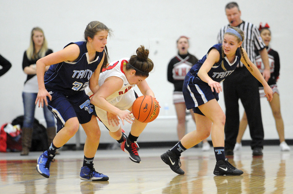 Watertown's Michaela Antonellis battles for possession of the ball with Triton's Alexandra Kennedy (left) and Morgan Snow during a sectional semifinal at Wakefield Memorial High School on Wednesday, Mar. 9, 2016. Watertown defeated Triton 43-29.