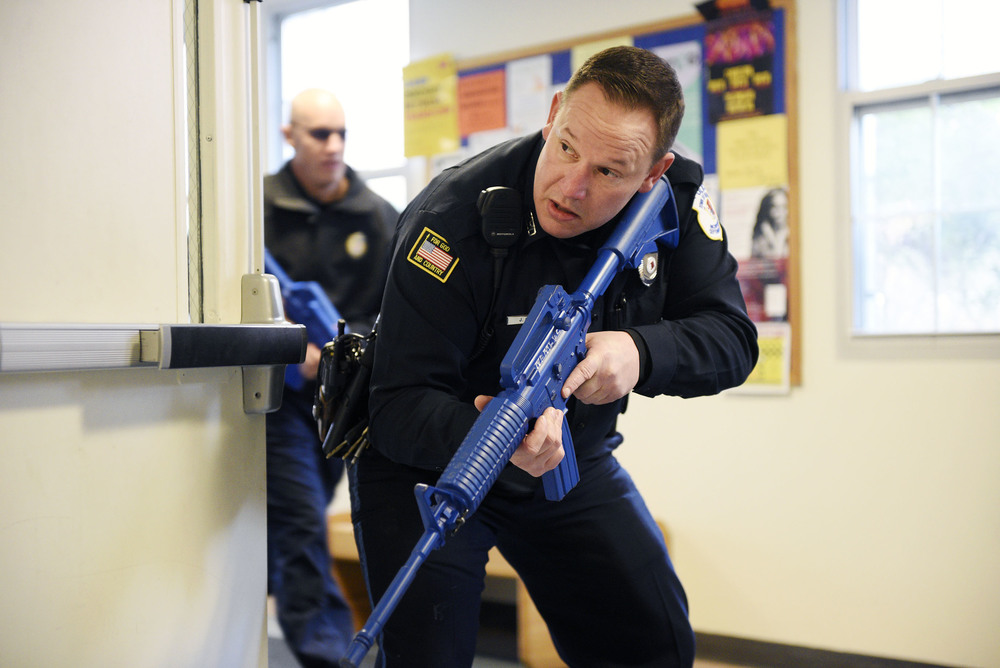 "An emergency management training drill simulating an ""active shooter on campus"" scenario was held at the Middlesex Community College Bedford campus in partnership with the Bedford, Billerica and Lowell police departments, and NEMLEC (Northeastern Massachusetts Law Enforcement Council) on Friday, Mar. 18, 2016.  Police officers respond on scene during the training drill simulating an ""active shooter on campus"" scenario at the Middlesex Community College Bedford campus."