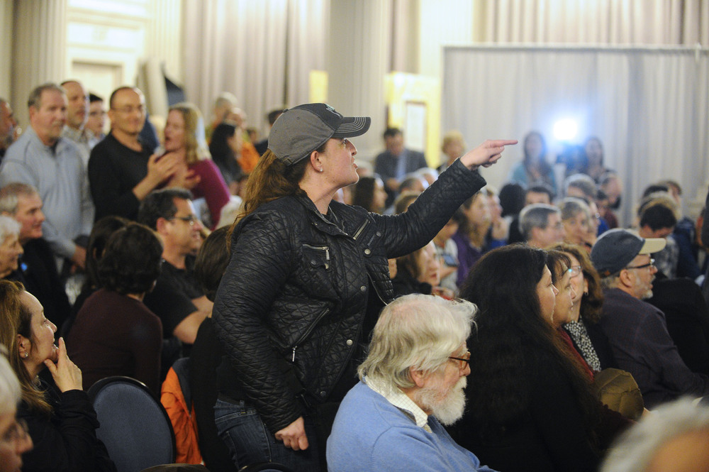 A woman yells out in frustration at the first annual community discussion about inclusivity within the Newton school system on Wednesday, Apr. 7, 2016 at Newton City Hall, following a series of anti-Semitic and racist incidents in the city.