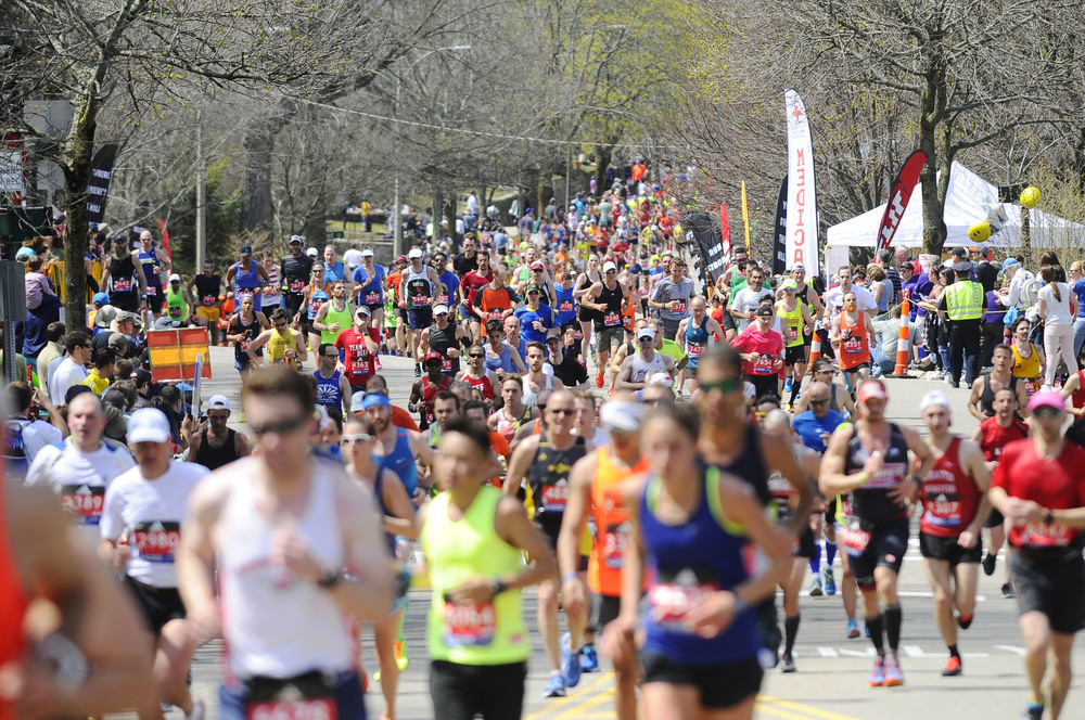 A wave of runners make their way up Heartbreak Hill in Newton during the 120th running of the Boston Marathon on Monday, April 18, 2016.