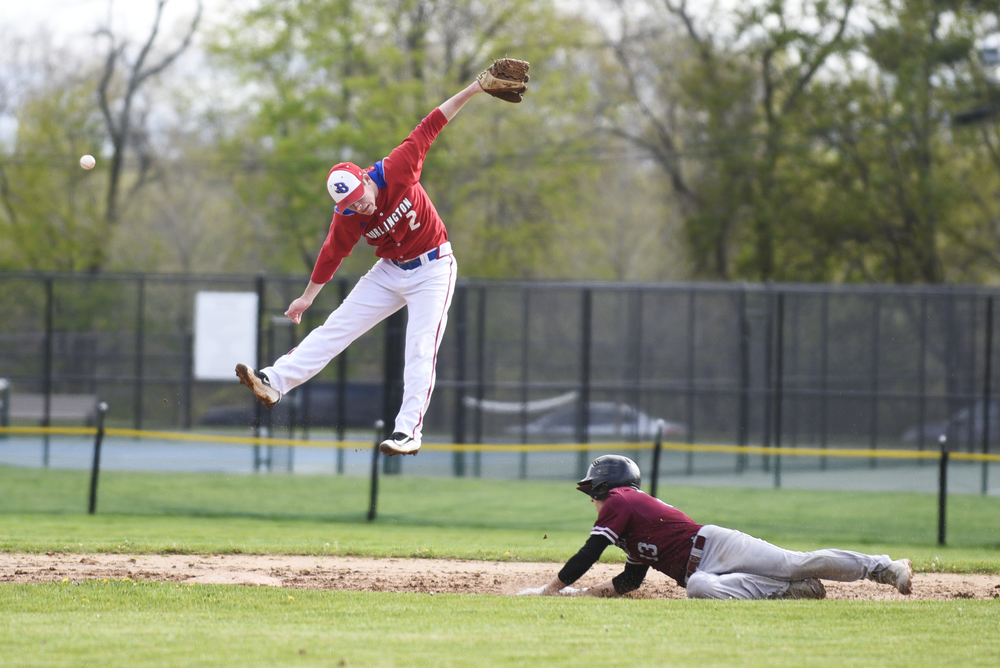 Arlington's George West dives safely into 2nd base as Burlington's Peter Lynch is unable to handle the wild throw on Friday, May 6, 2016.