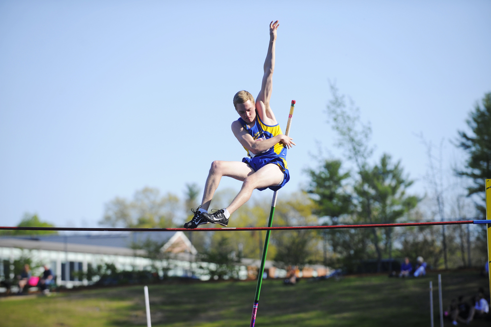 Acton-Boxborough's Owen VanDerAa clears the bar in the pole vault during a track and field meet at Acton-Boxborough Regional High School on Wednesday, May 11, 2016.