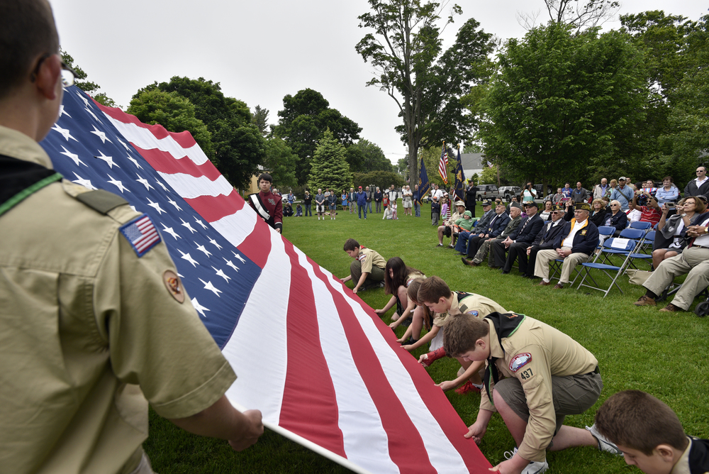 Boy Scouts from Troop 437 present the flag during a flag replacement ceremony during Westford's Memorial Day service on May 29, 2016.