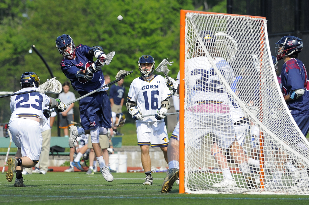 Belmont Hill's Johnny Hincks of Newton fires a shot for a goal while defended by Buckingham, Browne & Nichols Jackson Braley (23) of Wellesley on Friday, May 27, 2016.
