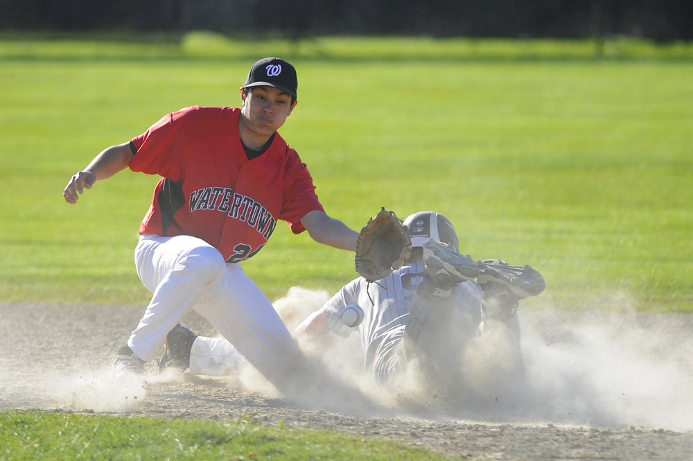 Watertown's Reid Shanabrook is unable to get his glove on the ball as Belmont's Connor Dacey steals 2nd base on Monday, May 9, 2016.