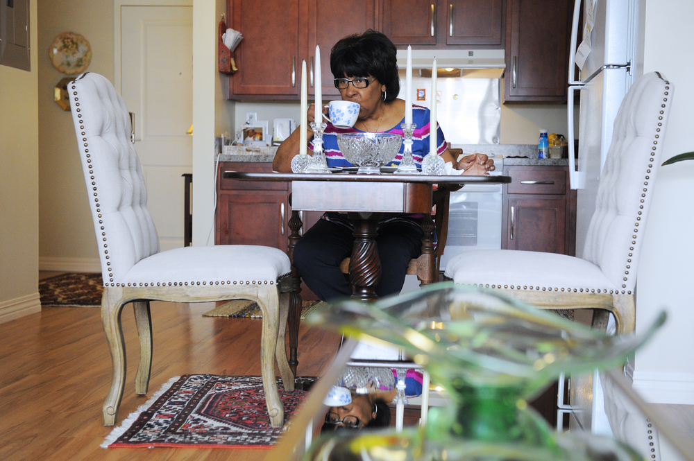 Betty Williams, 72, who is retired, drinks her coffee while eating breakfast in her home at a new affordable housing complex at 86 Dummer St., in Brookline on May 17, 2016.