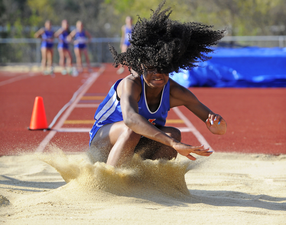 Newton South's Calene Lazare competes in the long jump during a track and field meet at Acton-Boxborough Regional High School on Wednesday, May 11, 2016.