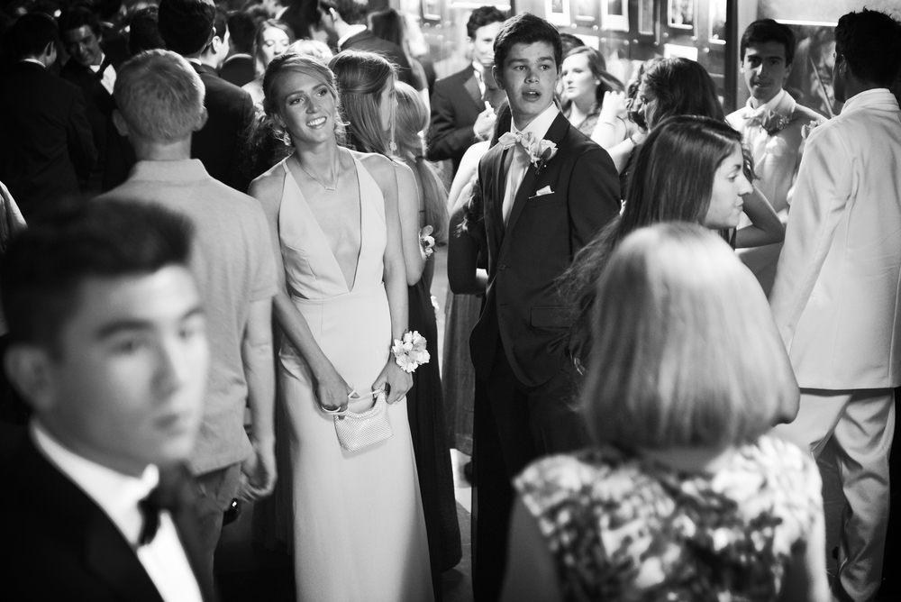 Senior Meggie MacAulay and junior Jacob Laffey watch as fellow students arrive at the traditional promenade at Belmont High School before buses take the students to prom on Friday, May 20, 2016.