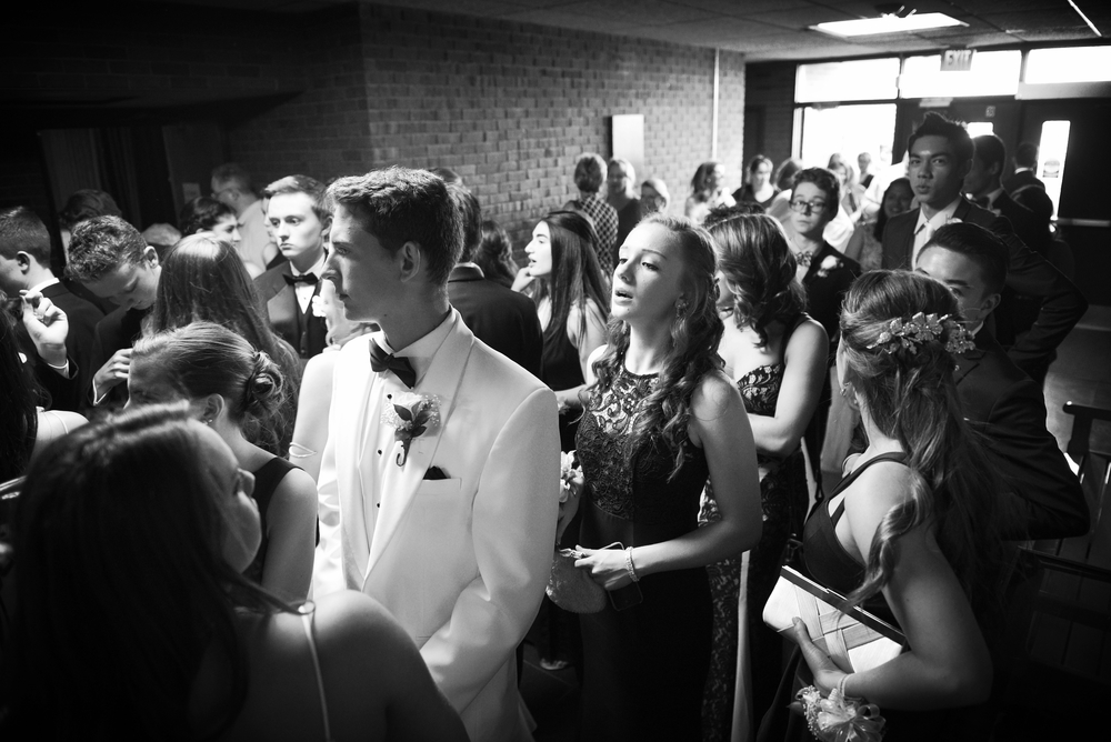Students line up for the traditional promenade at Belmont High School before buses take the them to prom on Friday, May 20, 2016.