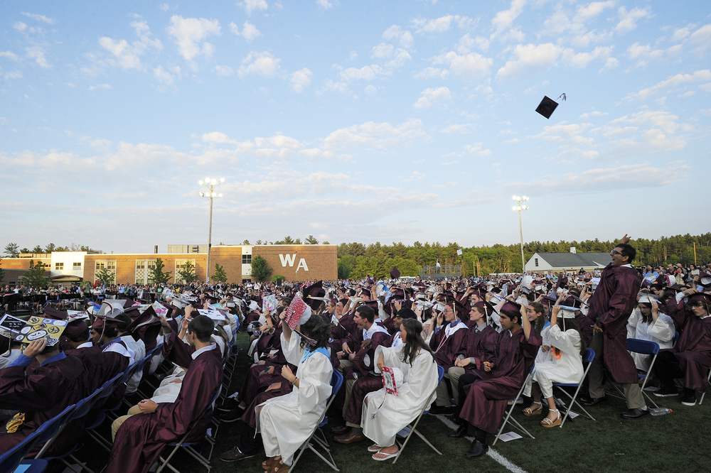 An excited graduate throws his cap into the air before anyone else during Westford Academy's graduation on Friday, June 3, 2016.
