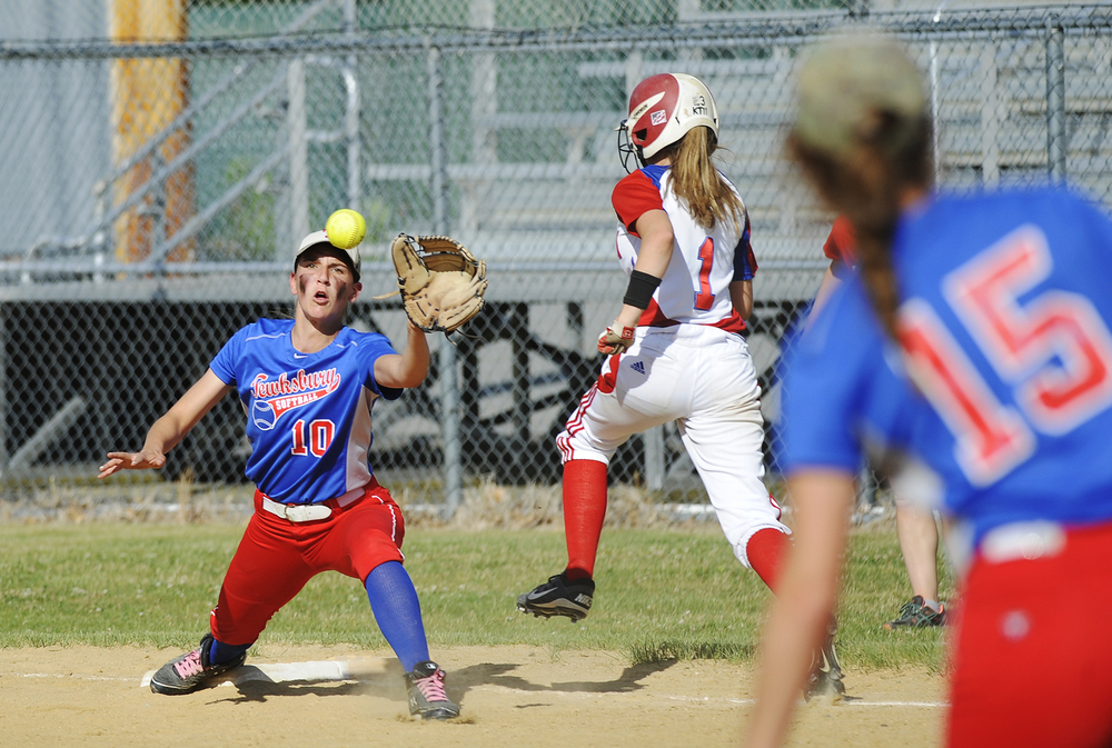 Tewksbury's Aurelie Petherbridge stretches at 1st base to make the catch and out against Burlington's Gabrielle Desrochers as teammate Kirsten Dick looks on from 3rd during the Div. 2 state semifinal at Martin Field in Lowell on Friday, June 10, 2016. Tewksbury won 3-2.