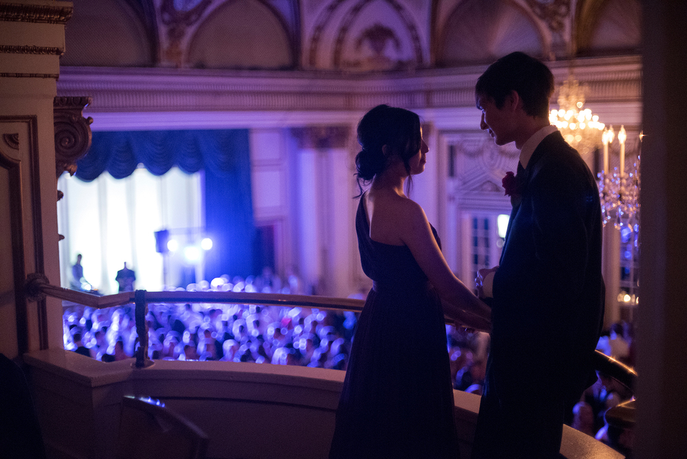 A couple share a moment together on the balcony level during Needham High School's prom at the Fairmont Copley Plaza in Boston on Thursday, June 2, 2016.