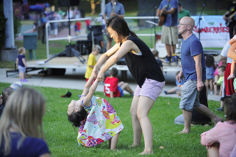 Sienna Moon, 3 1/2, of Belmont dances with her mother Stephanie Moon during a performance by Ethan Rossiter and the Jamberries on the first night of the Watertown Summer Concert Series at Saltonstall Park on Thursday, June 30, 2016.